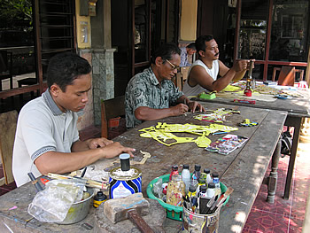 Family members Tri Suwarno, Sukardi, and Riyadi Dwi Susanto (left to right) work together to create wayang kulit. Photograph by Felcia Katz-Harris, Sewon, Bantul, 2007.
